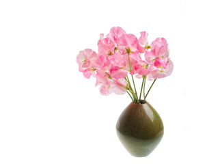 Small green vase with Sweet Pea flower boquet.