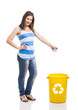 Beautiful young woman recycling