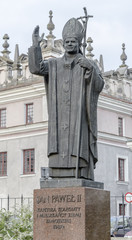Jan Paul II monument in the courtyard of the cathedral