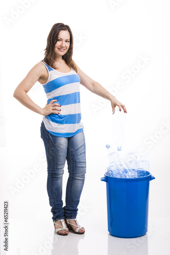 Beautiful young woman recycling