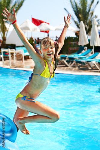 Leinwanddruck Bild Child jump in  swimming  pool.