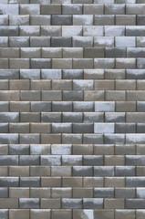 Grey dark brown wet weathered decorative abstract brick wall