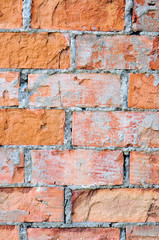 Red brick wall texture macro closeup, old detailed rough grunge