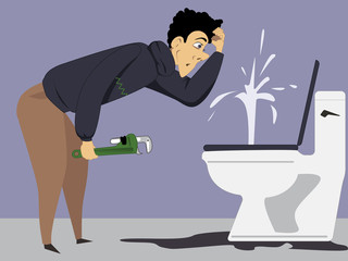 Puzzled man with a wrench looking at a broken toilet