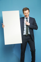 Joyful businessman carrying the white board