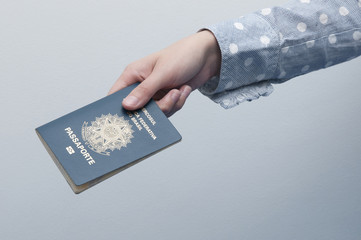 Caucasian Woman holding a brazilian passport