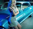 Smart woman next to the retro car