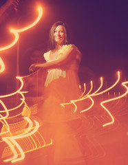 Dancing women  with lightpainting, long time exposure