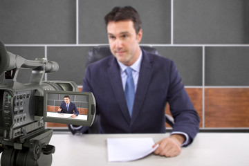 tv studio camera recording male reporter or anchorman