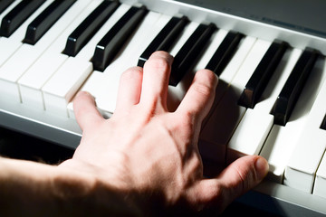 Hand on keyboard instrument