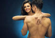 Cheerful young lady with her nude muscular husband