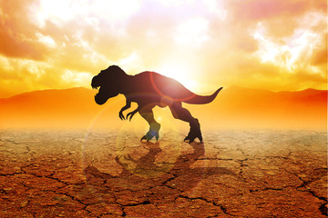 Silhouette of a tyrannosaurus rex on arid land