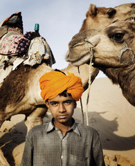 Young Indian Boy with Camels