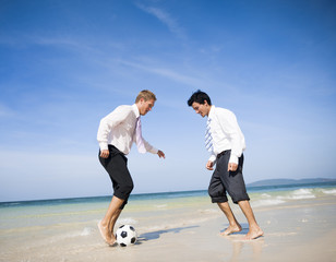 Two business men on beach