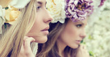 Portrait of the two gorgeous ladies with flowers - 65218497