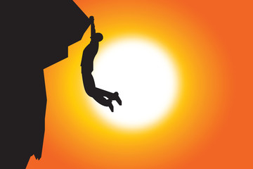Silhouette of man climbing in summer