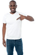 Smiling man pointing at blank white t-shirt