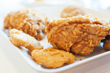 Fried chicken in window lighting .