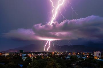 Lightning strike on the city mountain .