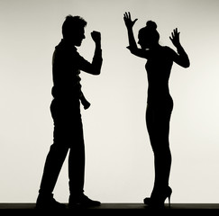Silhouette of arguing couple