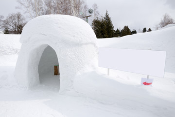 snow shelter with blank sign, for text or picture