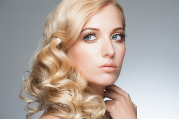 Blond with hairstyle and makeup