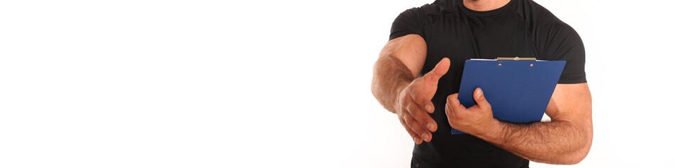 Fitnesstrainer mit Schreibbrett
