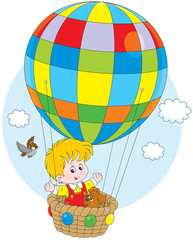 Little boy travelling with his pup on a balloon