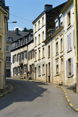 A curved street with houses in Belgian town of Bouillon