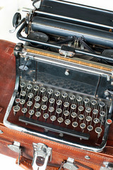 Old retro black metallic typewriter with antique round  keys.