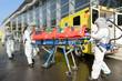 HAZMAT medical team pushing stretcher