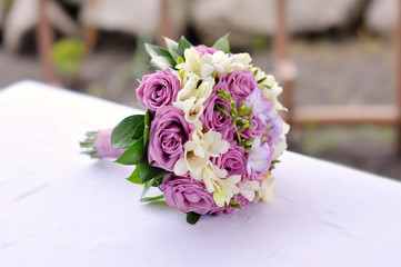 Bridal bouquet of purple roses
