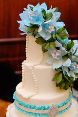 Detail of wedding cake with blue flowers