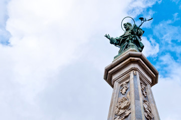 Saint Dominic statue and obelisk in Naples, Italy