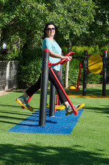 Woman working out on a air walker station outdoor