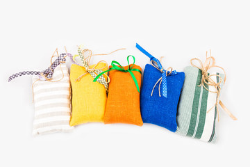 Decorative textile sachet pouches