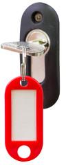 clé sur serrure avec porte-étiquette