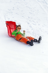 little boy having fun on the snow