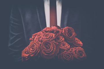 Man offers a bouquet of roses