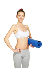 Fitness woman holding mat