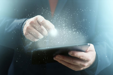 Man Holding Glowing and Sparkling Tablet