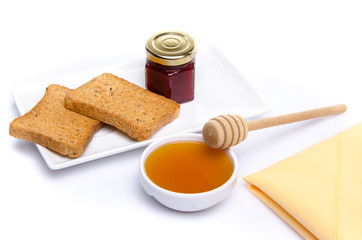 Composition of breakfast, honey, toasts,jam