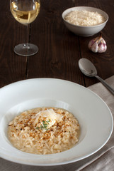 Risotto topped with shaved Parmesan and thyme