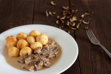 beef roast with mushrooms and home made croquettes