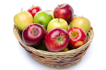 Different sorts of apples in a basket