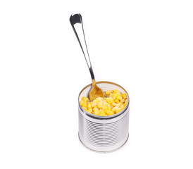 Canned corn in an opened can with spoon.