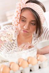 Young woman making dough