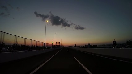 Twilight drive by the industrial area supporting Tokyo