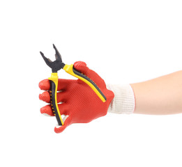 Hand in gloves holding pliers.