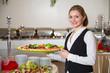 Leinwandbild Motiv Catering Service Angestellte hält ein Tablett mit Mozzarella